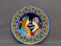 "Majolica plate modeled in the traditional shape called ""hat of the priest""."