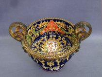 Ceramic centerpiece with snake handles painted with grotesques and Cupid