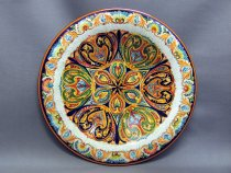 Faenza ceramic plate hand decorated with grotesque