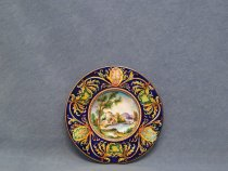 Plate ø 20 cm with Italian countryside landscape, farmhouses and stream. Hand painted plate in Faenza