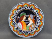 "Plate ""Amor Regnat"" modeled in the traditional shape called ""priest's hat"", an appreciated wedding or anniversary gift."