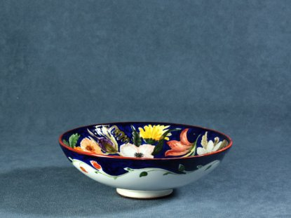 The exterior of the bowl painted with flowers, La Vecchia Faenza ceramics
