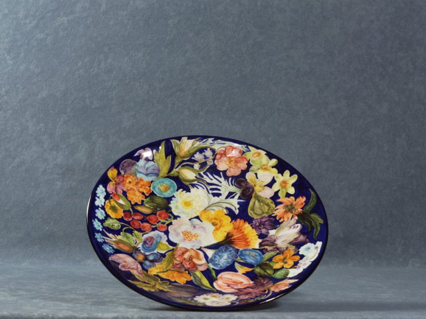 Raised fruit bowl painted with Flemish-inspired flowers, La Vecchia Faenza majolica