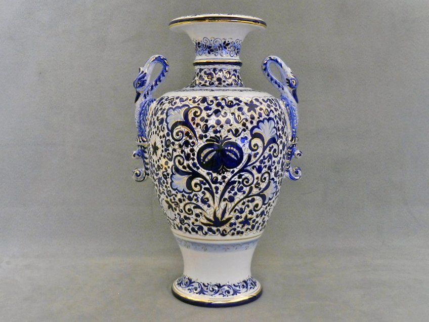 vase with handles in the shape of a swan and decorated pomegranate